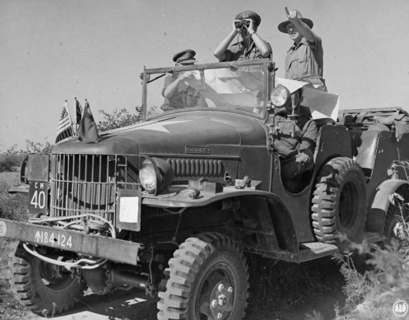 Adm. Lord Louis Mountbatten observing Mandalay from a distance aboard a WC command car, Burma, 13-18 Jan 1945 (Imperial War Museum: SE 1403)