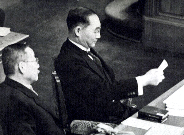 Japanese Prime Minister Mitsumasa Yonai reading a memo in the prime minister's seat in the Parliament chamber, Tokyo, Japan, 2 Feb 1940 (public domain via WW2 Database)