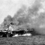 Carrier USS Ticonderoga burning after being hit by two kamikazes off Luzon, 21 Jan 1945 (US Navy photo)