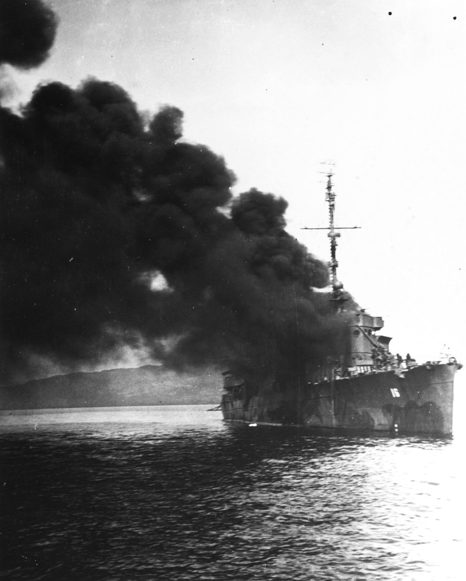 USS Ward on fire after being struck by a Japanese kamikaze in Ormoc Bay, Philippines, 7 Dec 1944, three years to the day after she fired the first US shot of the Pacific War (US Navy photo 80-G-270773)