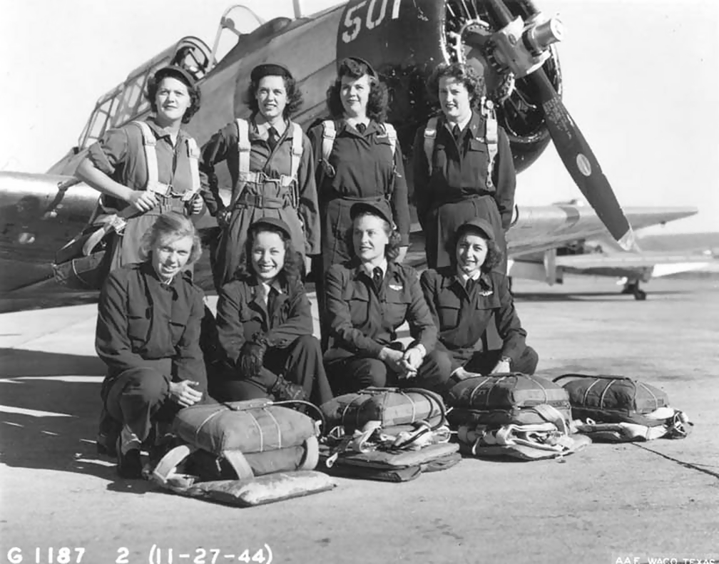 Eight WASP pilots in front of a North American AT-6 Texan a month before the WASPs were disbanded, Waco Army Airfield, Texas, 27 Nov 1944 (US Army Air Force photo)