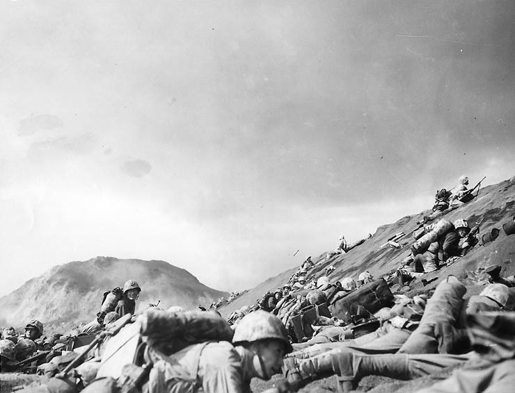 Men of USMC 5th Division advancing through the volcanic ash hills of Red Beach No. 1 at Iwo Jima, 19 Feb 1945 (US Naval History and Heritage Command)