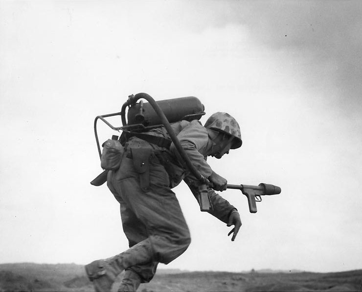 Man of US 9th Marines with flamethrower, Motoyama Airfield Number 2, Iwo Jima, Feb 1945 (US Naval History and Heritage Command)