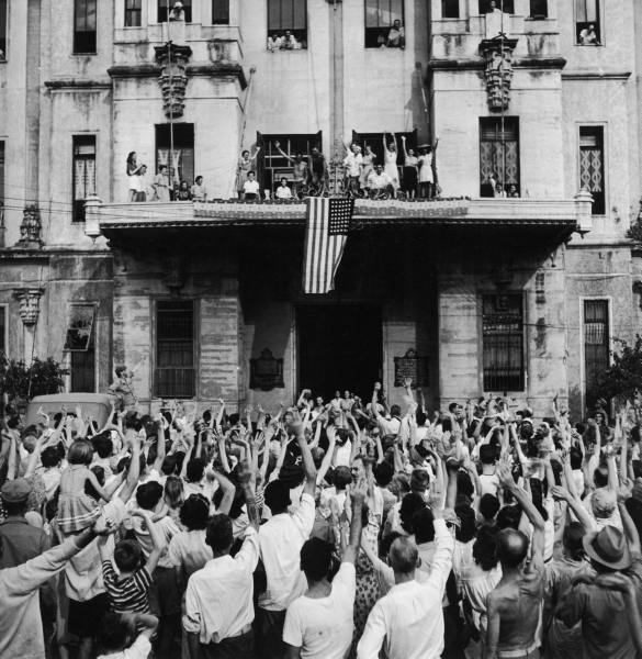Internees at the University of Santo Tomas in the Philippines celebrate their liberation, February 1945. (LIFE, public domain)
