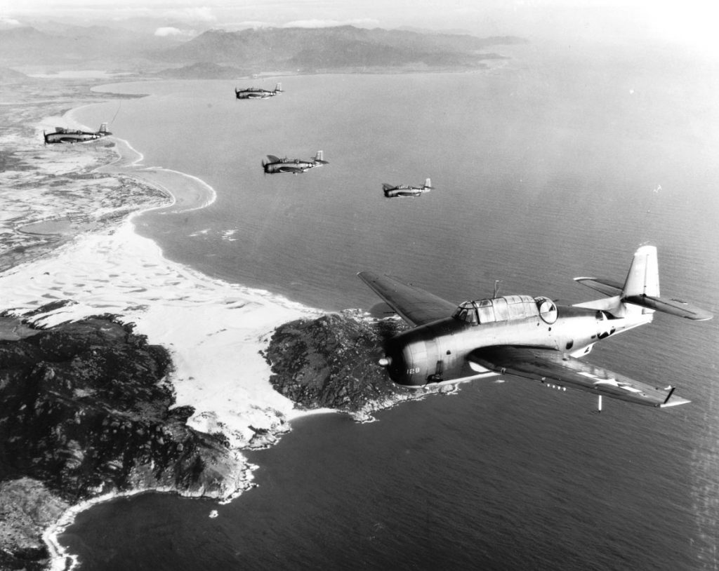 TBM-1C Avengers of Torpedo Squadron 4 from carrier USS Essex crossing the Indochinese coast on their way to bomb shipping at Saigon, 12 Jan 1945 (US Navy photo: 80-G-300673)