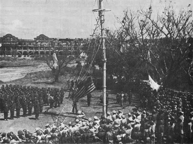 US troops raise the flag on Corregidor in the Philippines, 2 March 1945 (US Army Center of Military History)