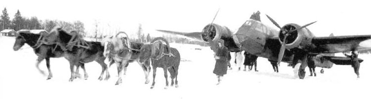 Blenheim light bomber of the RAF being towed away by horses after landing on the frozen Jukajärvi lake, near Juva village, Finland, 25 Feb 1940 (public domain via WW2 Database)