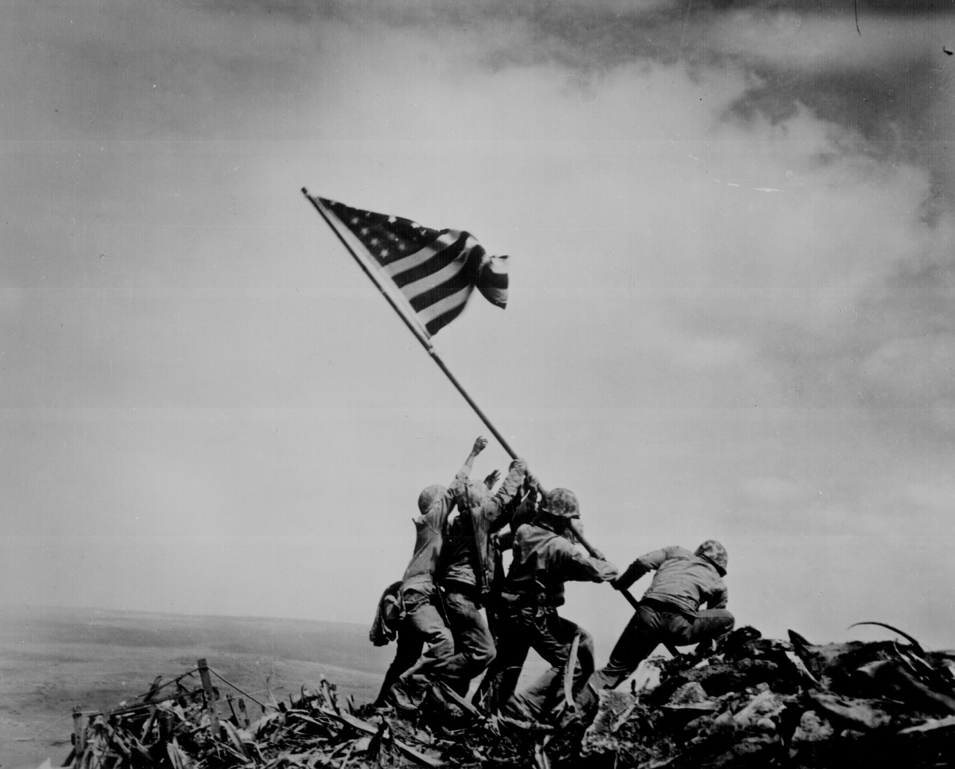 Raising the US flag atop Mount Suribachi, by Joe Rosenthal, Iwo Jima, 23 Feb 1945. (US National Archives: 80-G-413988)