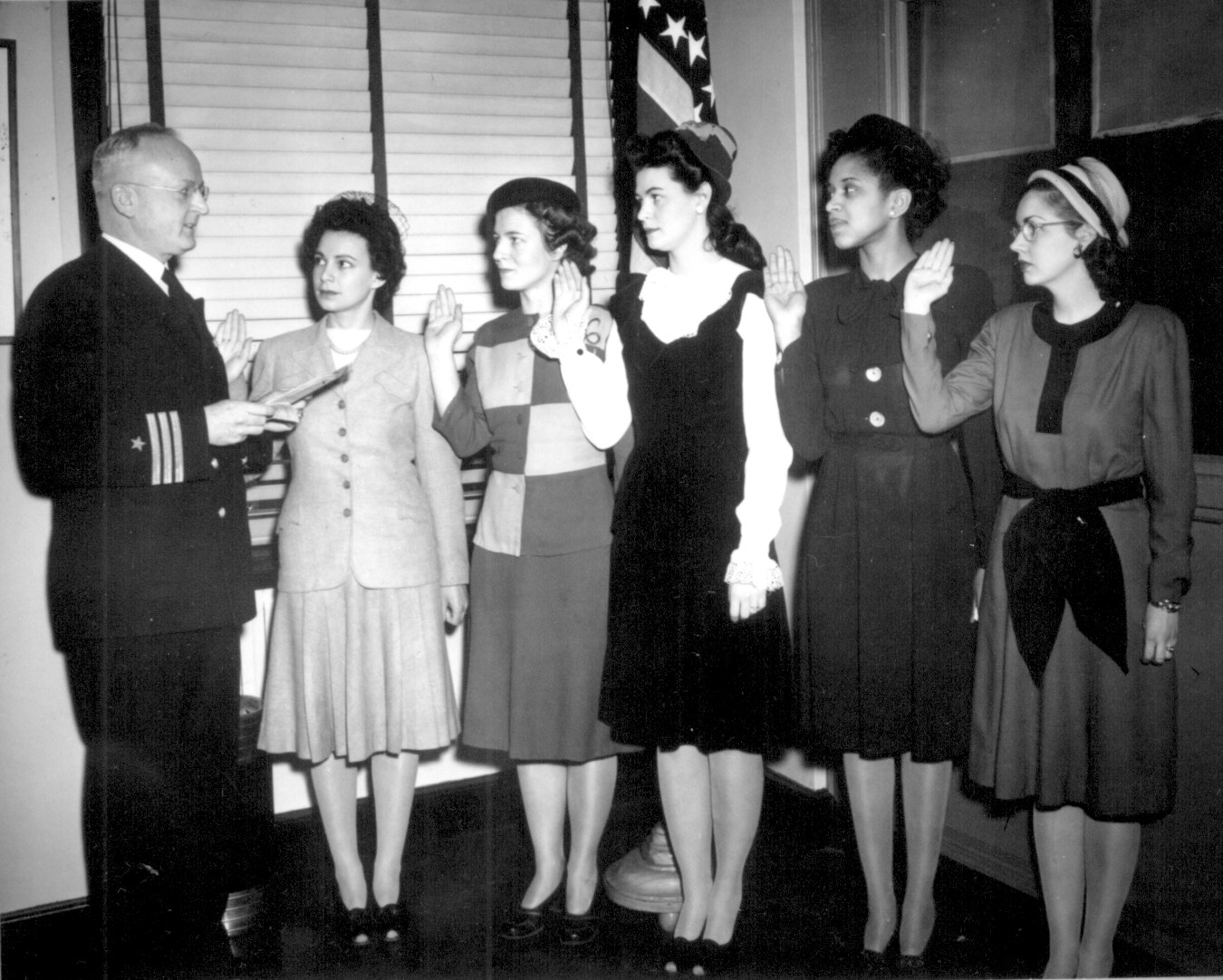 US Navy Cdr. Thomas Gaylord administering oath to nurses commissioned in New York, 8 Mar 1945; Phyllis Mae Daley, US Navy's first African-American nurse, second from right. (US National Archives: 80-G-4836)