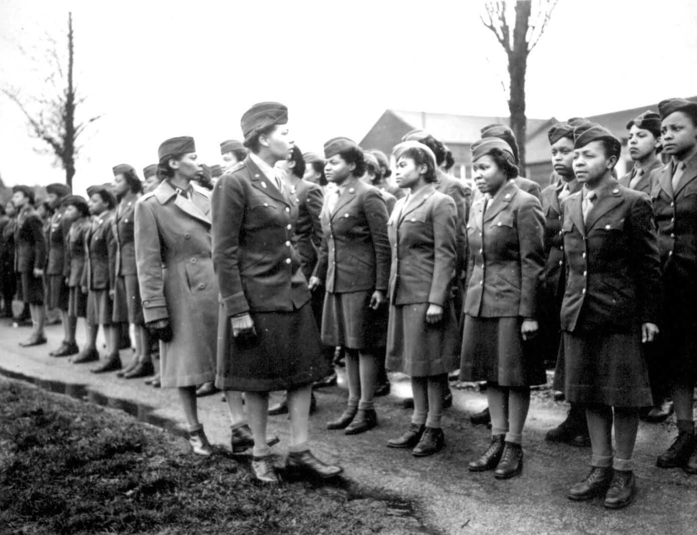 WAC Major Charity E. Adams and Captain Abbie N. Campbell inspecting members of the 6888th Central Postal Directory Battalion, England, 15 Feb 1945 (US National Archives: 111-SC-20079)