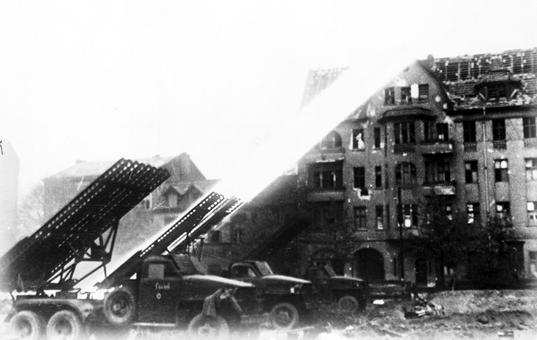 Soviet BM-13 Katyusha rocket launchers firing on Berlin, Germany, Apr 1945 (public domain, Russian Archives)
