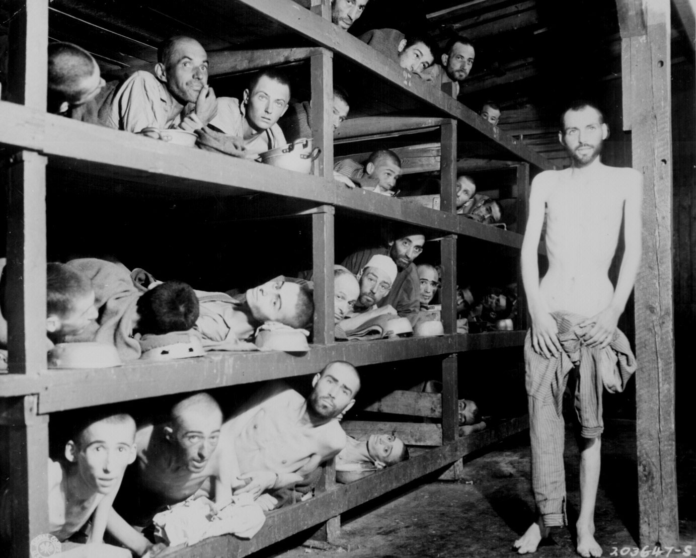 Prisoners at Buchenwald concentration camp, Germany, 16 Apr 1945; author Elie Wiesel is in the second row up, seventh from the left, next to the bunk post (US National Archives: 208-AA-206K-31)