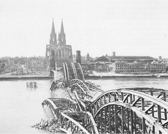 Demolished Hohenzollern Bridge at Cologne, Germany, March 1945 (US Army Center of Military History)
