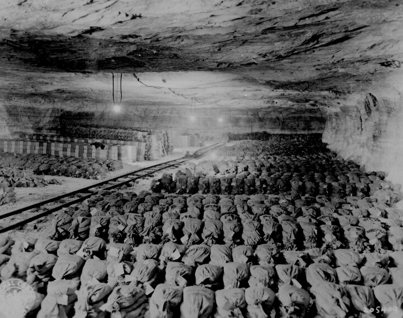 Precious metals, paintings, and other loot hidden by Germans in a salt mine near Merkers, Germany, photographed 15 Apr 1945 (US National Archives: 239-PA-6-34-2)