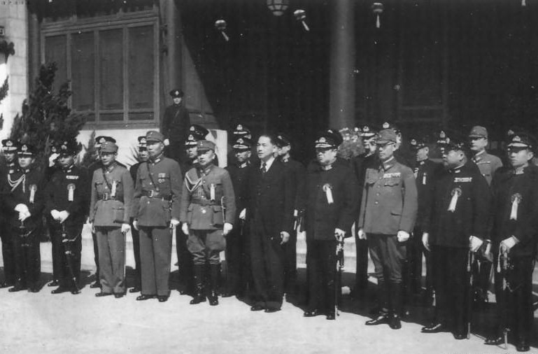 Wang Jingwei and military officers at the ceremony establishing a Japanese government in Nanjing, China, 30 Mar 1940 (public domain via WW2 Database)