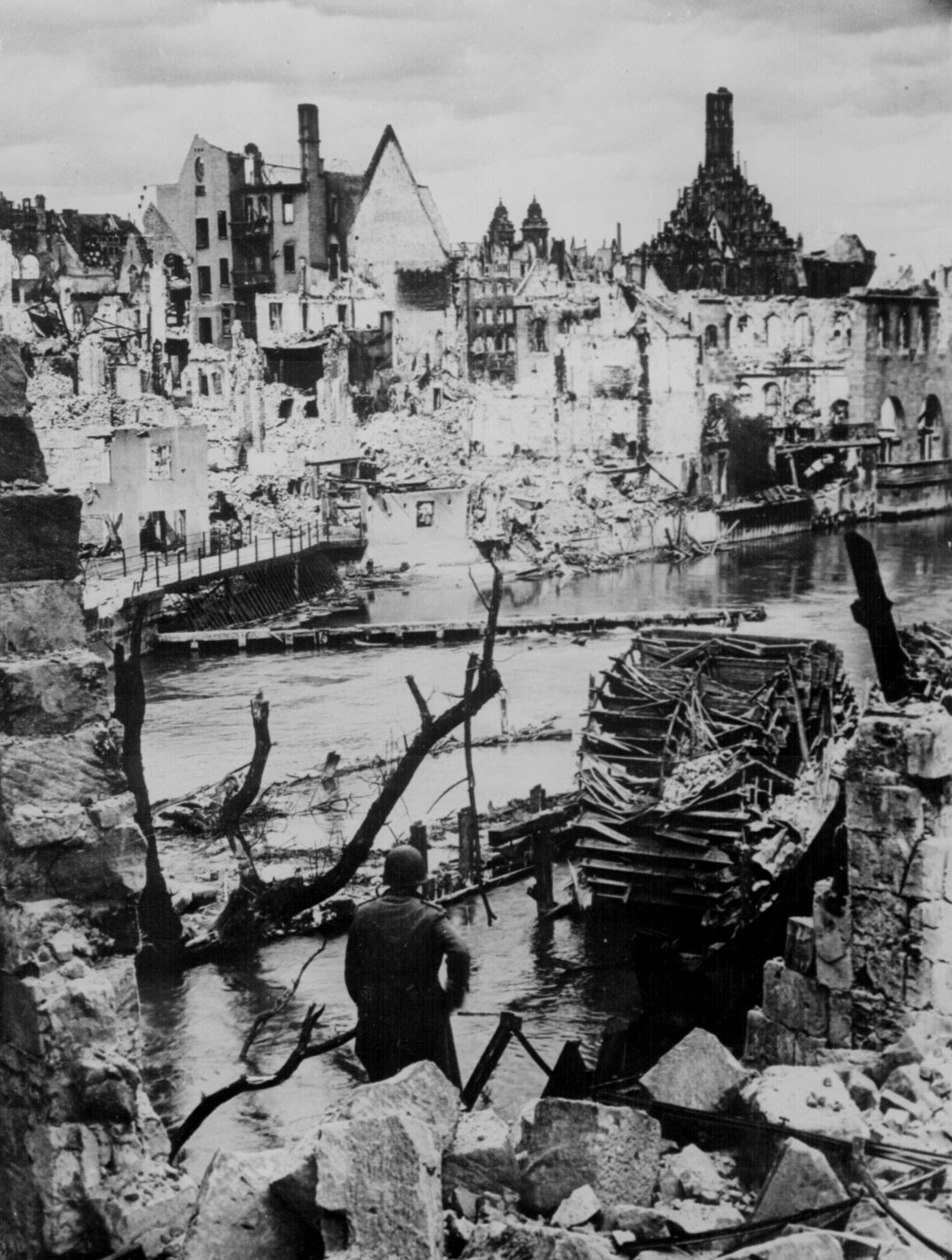An American soldier observed the destruction of an industrial town near Nuremberg, Germany, 20 Apr 1945 (US National Archives: 208-AA-207L-1)