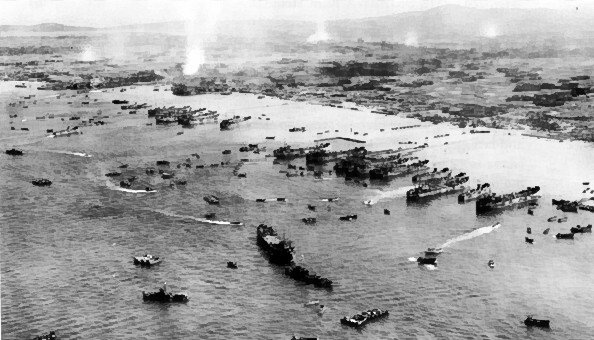American ships unloading supplies on the beach of Okinawa, Japan, 4 Apr 1945 (US Army photo)