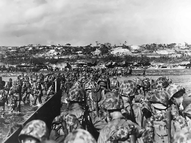 Men of the US Tenth Army landing on Okinawa, Japan, 1 Apr 1945 (US National Archives: 39573-FMC)