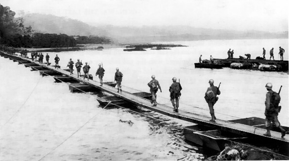 US Army soldiers crossing the Machinato Inlet on foot bridge, Okinawa, 19 Apr 1945 (US Army photo)