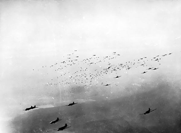 C-47 transports releasing hundreds of paratroopers and their supplies over the Rees-Wesel region, Germany during Operation Varsity, 24 Mar 1945 (Imperial War Museum: 4700-06 EA 59364A)