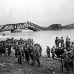 Men of the British 1st Cheshire Regiment crossing the Rhine River with Buffalo tracked landing vehicles at Wesel, Germany, 24 Mar 1945. (Imperial War Museum: 4700-30 BU 2336)