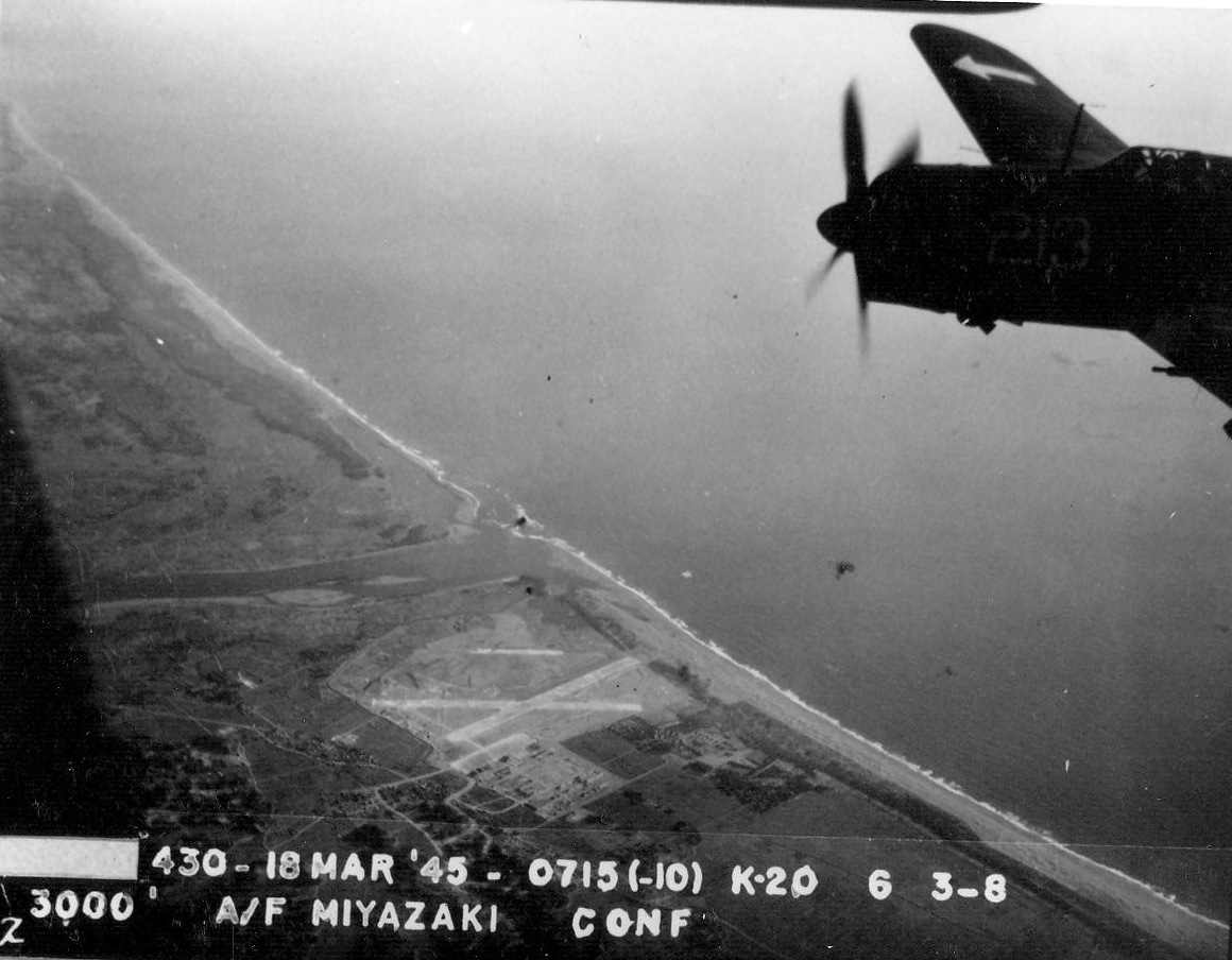 Strike photo taken by aircraft from USS Bunker Hill showing an SB2C Helldiver of Squadron VB-84 over Miyazaki Airfield on southern Kyushu, Japan, 18 Mar 1945 (National Museum of Naval Aviation)