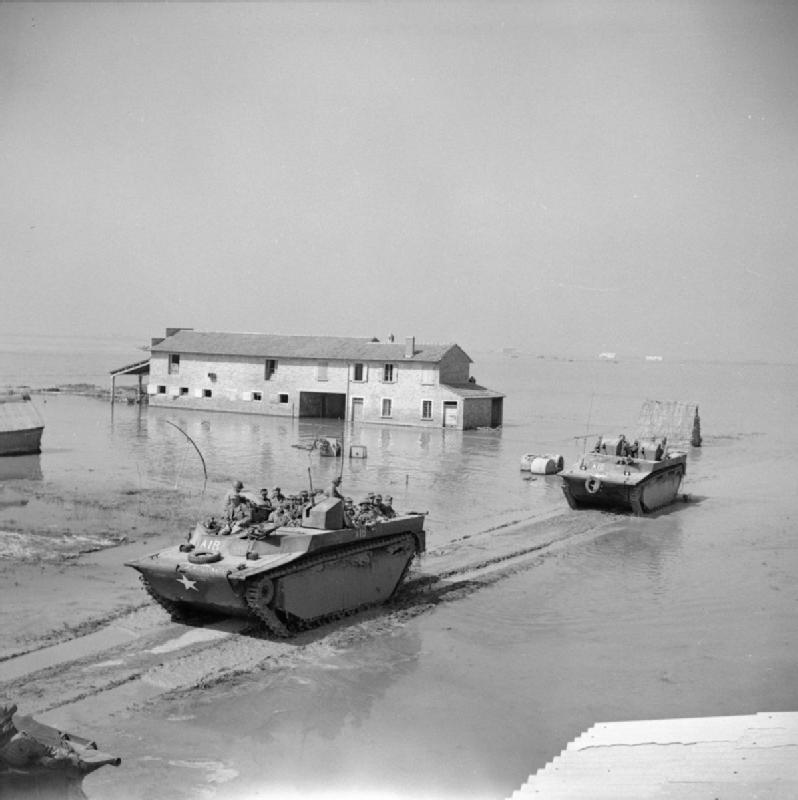 'Fantails' or Buffalo amphibians transport German prisoners through a flooded landscape south of Comacchio Lagoon, Italy, 11 April 1945 (Imperial War Museum: NA 23992)