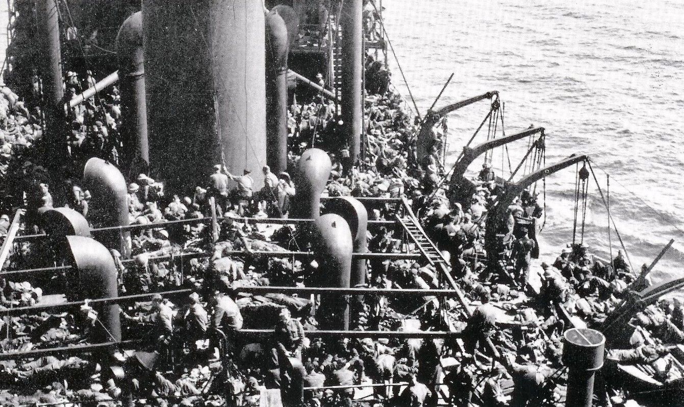 Allied troops aboard the ship Guinean after being evacuated from Dunkirk, late May 1940 (public domain via WW2 Database)