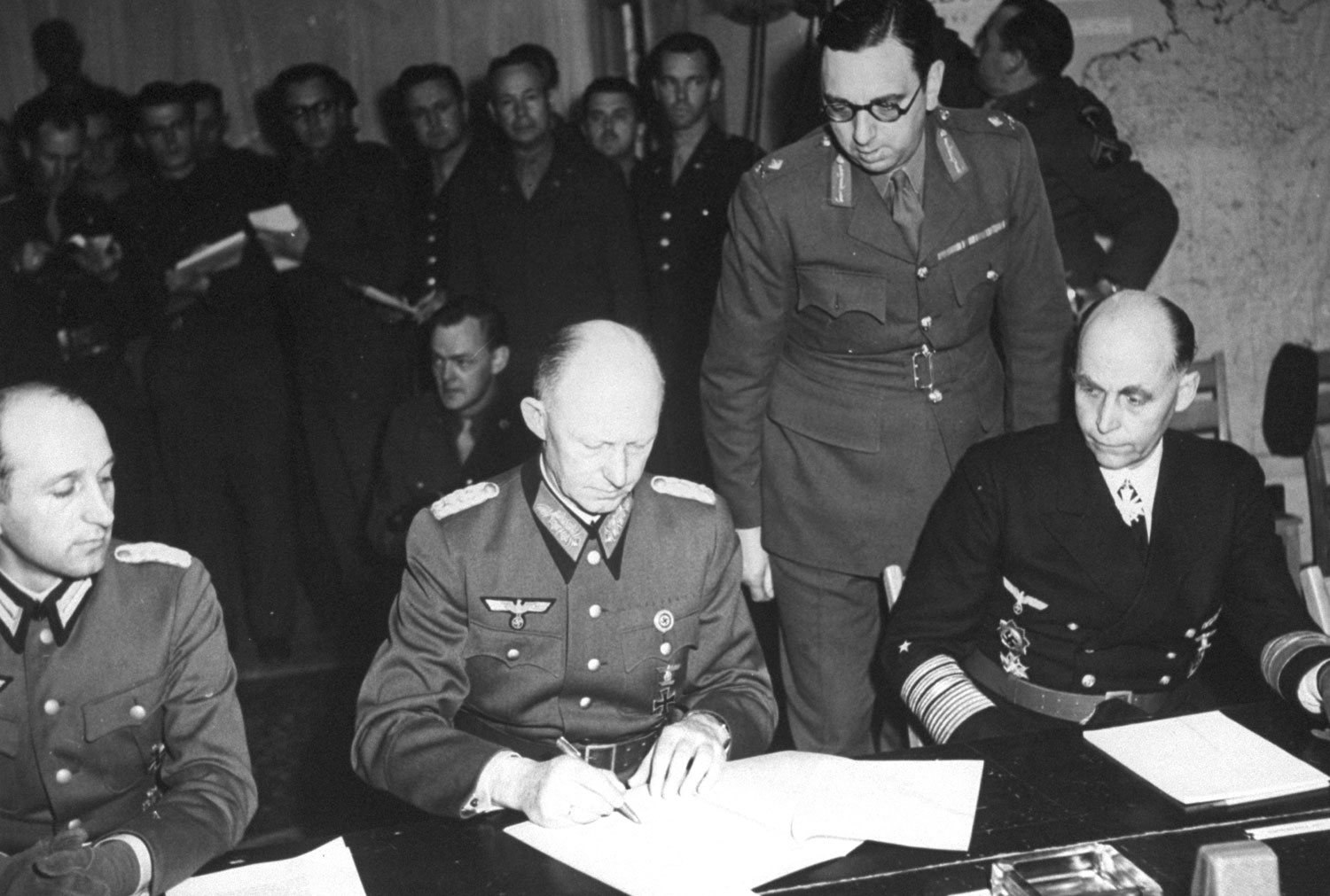 ColGen Alfred Jodl signing the documents of Germany's surrender, Reims, France, 7 May 1945. (US Army Signal Corps photo)