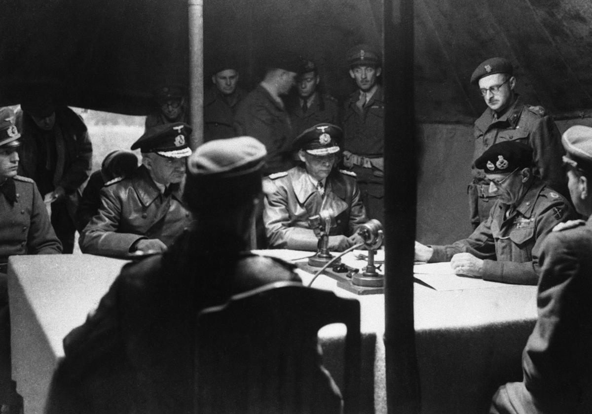 Gen. Bernard Montgomery reading surrender document to German officers at British 21st Army Group headquarters, Lüneburg Heath, Germany, 4 May 1945 (Imperial War Museum: BU 5208)