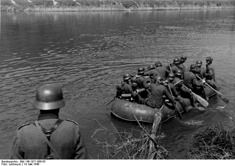 German troops crossing the Meuse River in a rubber raft, near Aiglemont, France, 14 May 1940 (German Federal Archive, Bild 146-1971-088-63)