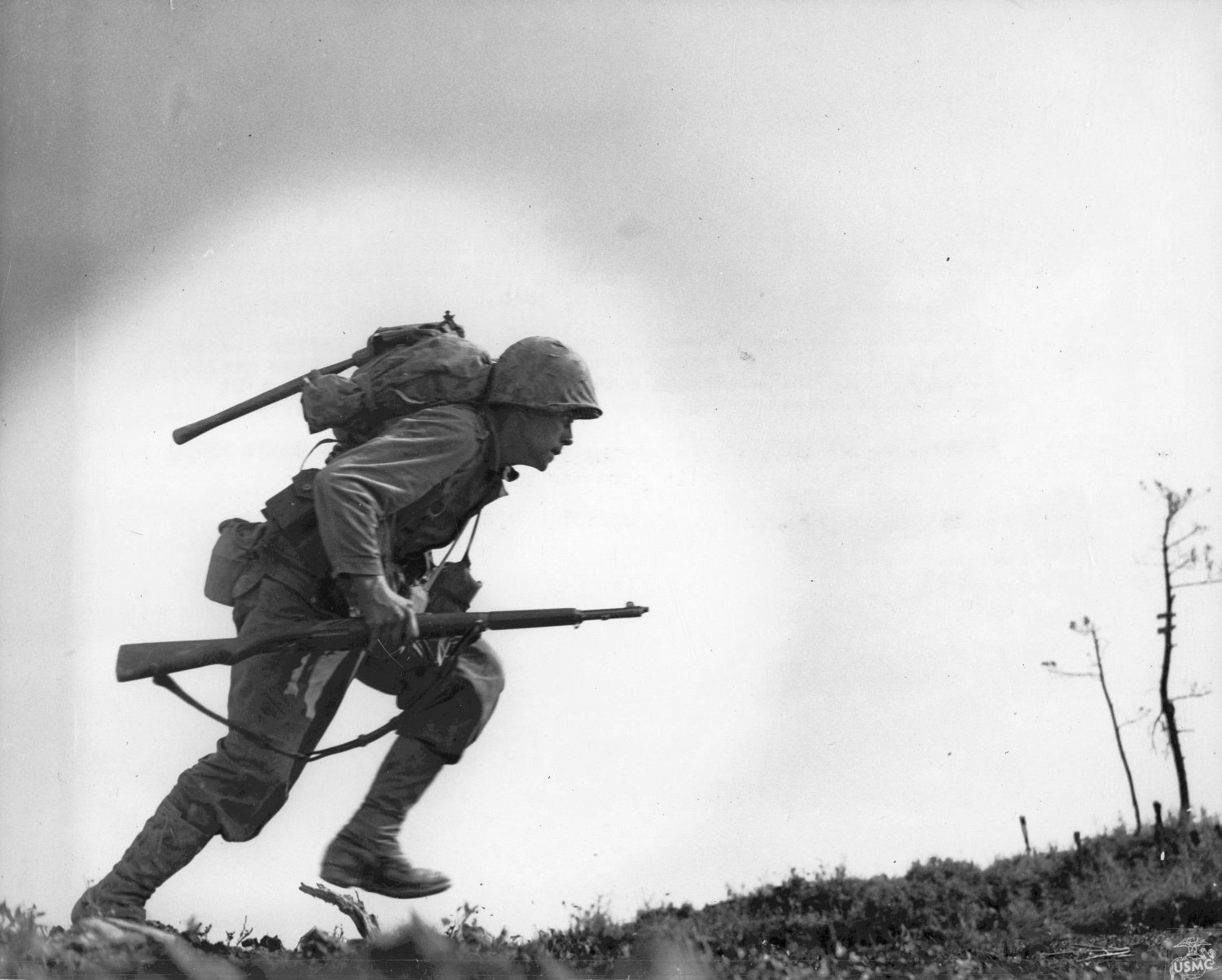 US Marine running through Japanese fire at 'Death Valley,' Okinawa, Japan, 10 May 1945 (US National Archives: 41607-FMC)