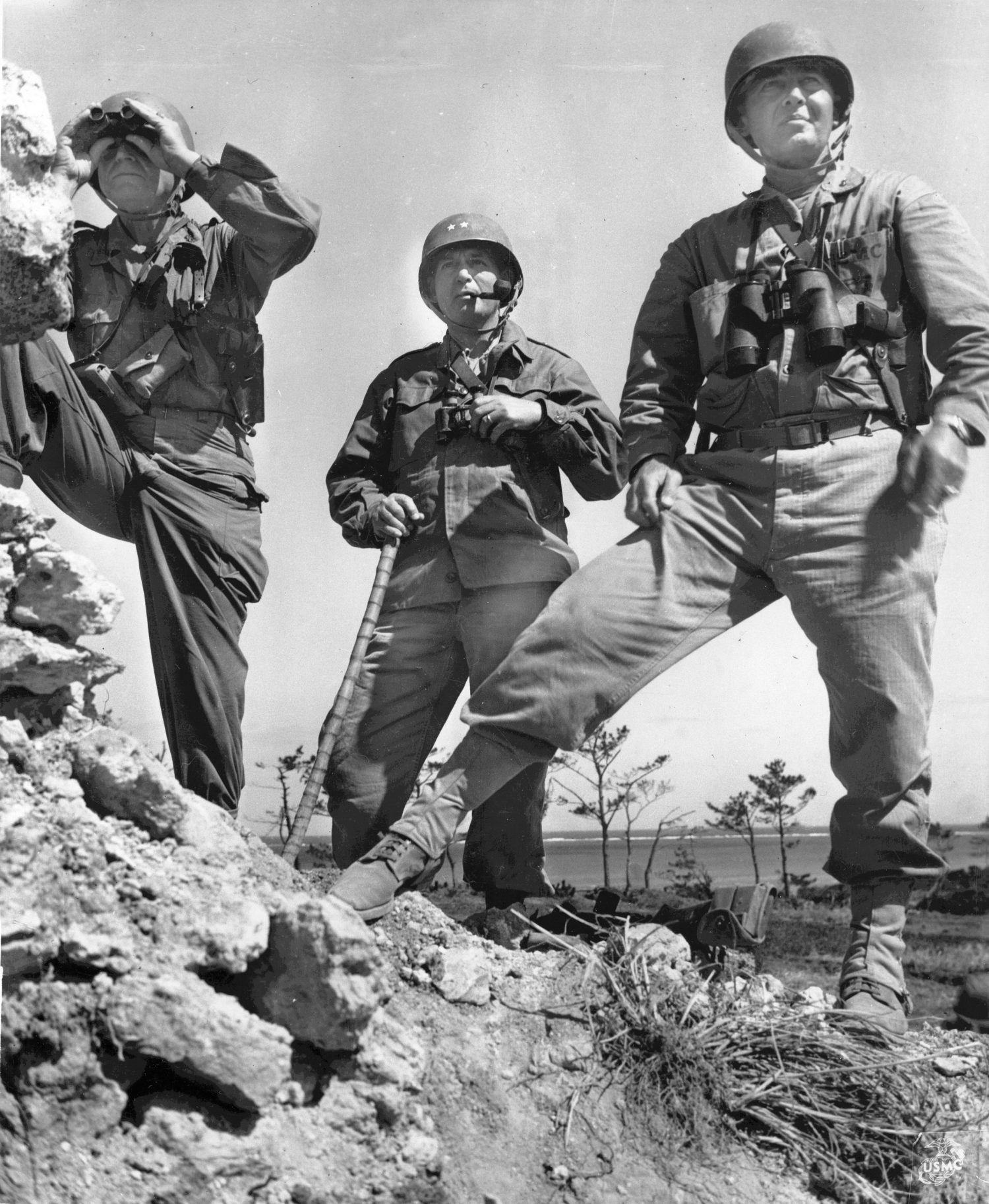 Lt. Gen. Simon Buckner, Jr., Maj. Gen. Lemuel Shepperd, and Brig. Gen. William Clement on Okinawa, 22 May 1945 (US Marine Corps photo)