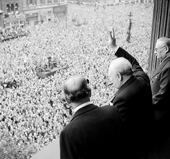 Churchill waving to crowds at Whitehall, London, on the day the war with Germany was won, 8 May 1945 (Imperial War Museum: 4700-37 H 41849)
