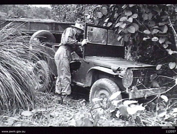 Australian Army Lieutenant MG Searles, 2/25 infantry battalion, inspecting a Japanese vehicle found abandoned near Balikpapan, Borneo, 22 Jul 1945. (Australian War Memorial 112057)