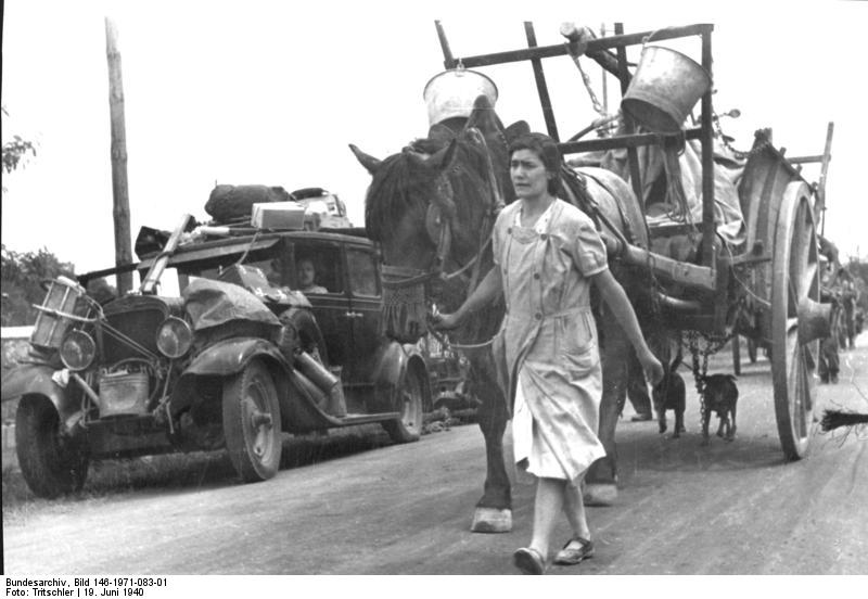French refugees on a road near Gien, France, 19 Jun 1940. (German Federal Archive: Bild 146-1971-083-01)