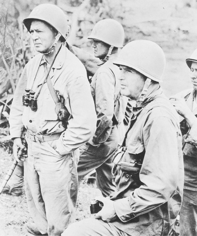 Lt. Gen. Simon B. Buckner, Commanding General, US Tenth Army (right, with camera) and Maj. Gen. Lemuel C. Shepperd, Jr., Commanding General, 6th Marine Division, Okinawa (with walking stick), June 1945 (US Army Center of Military History)