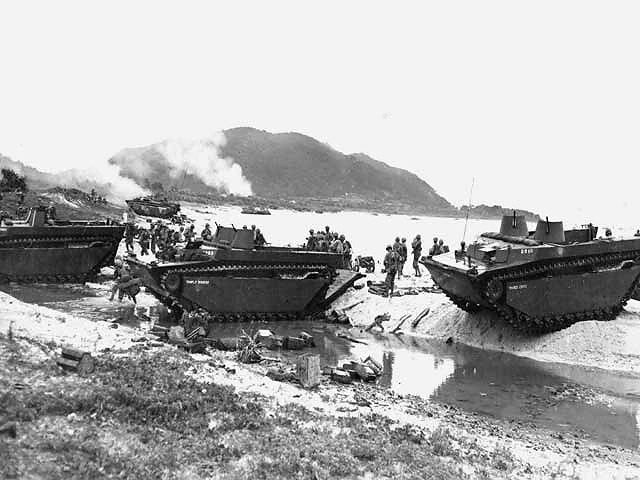 Amphibious tractors delivering US Marines and supplies on the beach of Iheya Shima, 3 Jun 1945 (US National Archives: 126988)