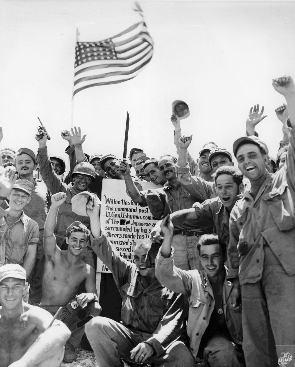 US Marines and US Army soldiers celebrating the capture of Hill 89, Okinawa, Japan, 27 Jun 1945; the hill was captured by US 7th Inf Div on 21 Jun 1945. (US Marine Corps photo)
