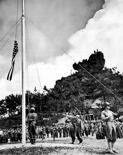 Raising the US flag on Okinawa, Japan, 22 Jun 1945 (US Army photo)
