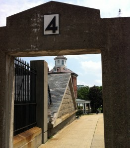 Gate 4 at the Charlestown Navy Yard in Boston. Through the gate you can see the Ropewalk and the Muster House (Photo: Sarah Sundin, July 2014)
