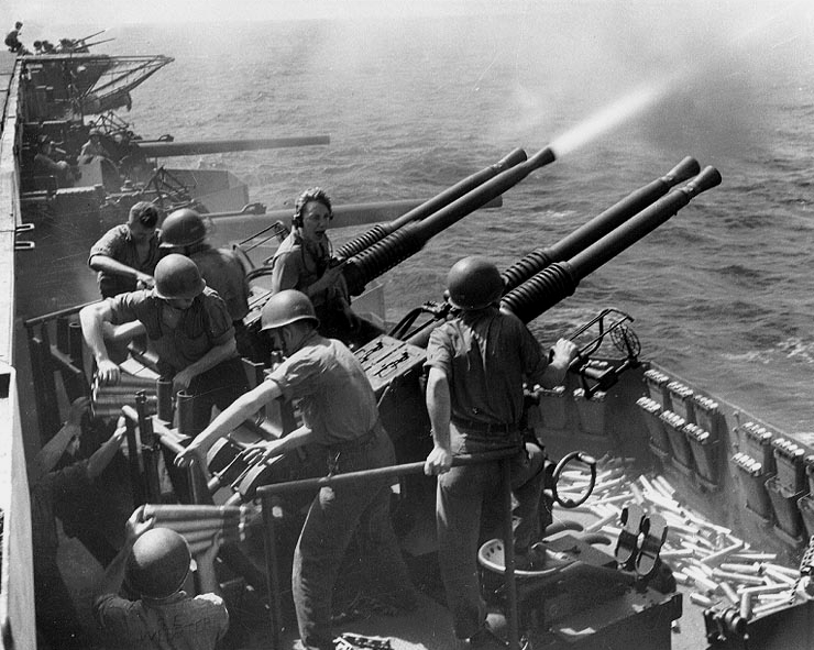 Bofors 40-mm antiaircraft guns firing on board carrier USS Hornet, 16 Feb 1945 (US Navy photo: 80-G-413915)