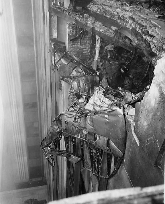 Wreckage of the B-25 that crashed into the Empire State Building, 28 Jul 1945 (Acme Newspictures, public domain via Wikipedia)