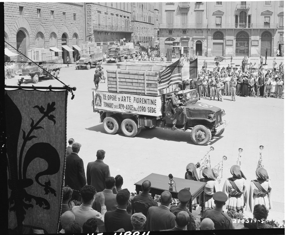 American trucks returning part of $500 million worth of Florentine artwork looted by Germans, Piazzo Dei Signoria, Florence, Italy, 21 Jul 1945 (US National Archives: 111-SC-210319)