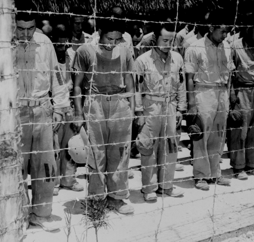 Japanese POWs at Guam listen to Emperor Hirohito's surrender announcement, 15 Aug 1945 (US National Archives: 80-G-490320)