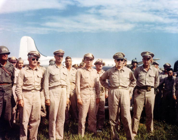 Gen. Douglas MacArthur arriving at Atsugi Airfield near Tokyo, 30 Aug 1945, with Maj. General Joseph Swing, Lt. Gen. Richard Sutherland, and Gen. Robert Eichelberger (US National Archives: USA C-1732)