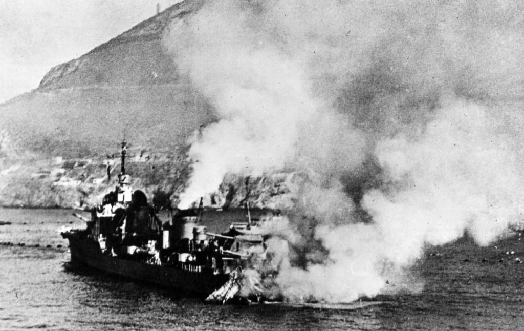 French destroyer leader Mogador burning after bombardment at Mers-el-Kebir, Algeria, 3 July 1940 (public domain via Wikipedia)