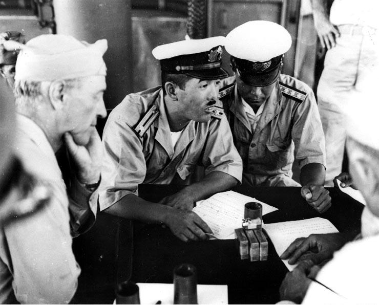 Surrender negotiations at Mille Atoll, Marshall Islands, aboard USS Levy, 19 Aug 1945 (US National Archives: 80-G-490371)