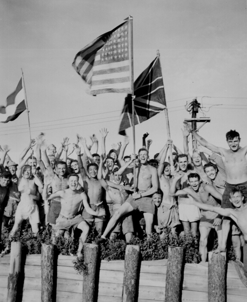 Allied prisoners of war at Omori camp near Yokohama cheer as US Navy and other Allied personnel arrive to rescue them, 29 Aug 1945 (US National Archives: 80-G-490444)