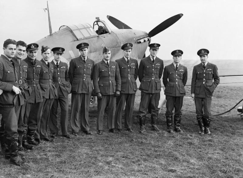 Pilots of No.1 Squadron RCAF with a Hawker Hurricane at Prestwick, Scotland, 30 October 1940 (Imperial War Museum: CH 1733)